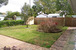 There's a large fenced rear yard with new paver paths - lots of space to enjoy.