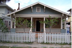 A charming bungalow near Round Lake with a white picket fence.